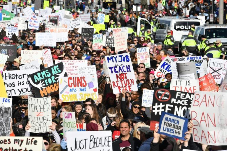 People arrive for the March For Our Lives rally against gun violence in Washington, DC