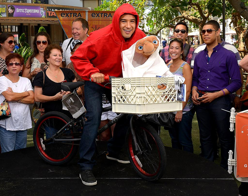 "<p class=""MsoNormal"">Elliott, is that you? Mario Lopez entertained spectators on the set of his show ""Extra"" at L.A.'s The Grove when he recreated an iconic scene from the Steven Spielberg film ""E.T.,"" which just marked its 30<sup>th</sup> anniversary recently. ""E.T. Phone home! 30 year anniversary of E.T. today,"" Lopez <a target=""_blank"" href=""https://twitter.com/MarioLopezExtra/statuses/255424099919204352"">tweeted</a> on Monday. ""One of my all-time favorite movies. #ClassicFlick."" (10/8/2012)</p>"
