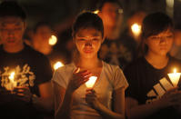 FILE - In this June 4, 2015 file photo, people attend a candlelight vigil at Victoria Park in Hong Kong. The group, Hong Kong Alliance in Support of Patriotic Democratic Movements of China, that had organized annual vigils in remembrance of victims of the Chinese military's crushing of the 1989 Tiananmen Square pro-democracy protests voted to disband Saturday, Sept. 25, 2021 amid an ongoing crackdown on independent political activism in the semi-autonomous Chinese city. (AP Photo/Vincent Yu, File)