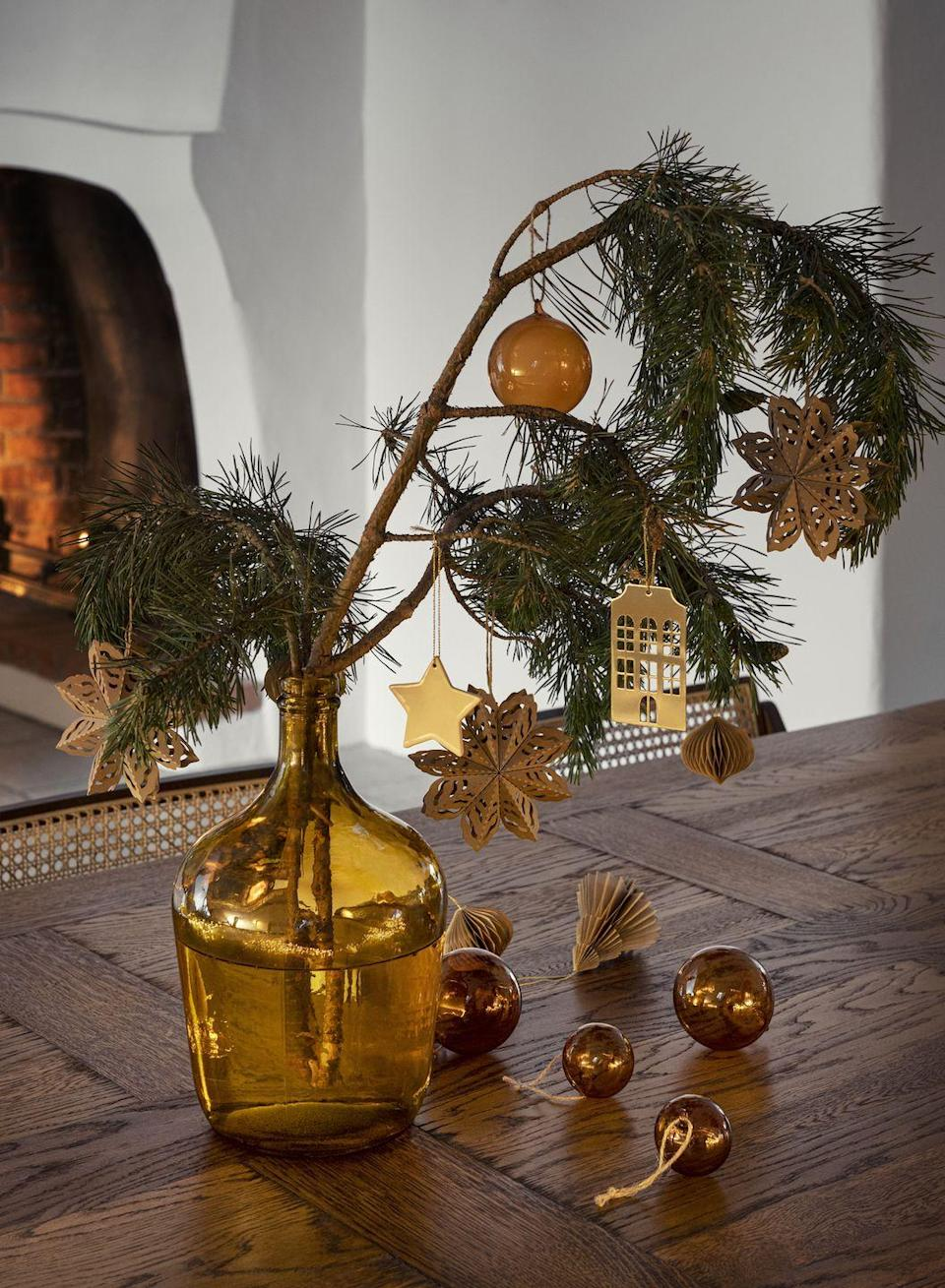 "<p>'Key pieces from the Christmas collection includes a wide range of warm blankets, seasonal cushion covers and plump vases in recycled glass,' says the team. </p><p>We've got our eye on this recycled glass vase, perfect for filling with some festive foliage. </p><p><a class=""link rapid-noclick-resp"" href=""https://go.redirectingat.com?id=127X1599956&url=https%3A%2F%2Fwww2.hm.com%2Fen_gb%2Fhome%2Fseasonal-trending%2Fchristmas.html&sref=https%3A%2F%2Fwww.housebeautiful.com%2Fuk%2Flifestyle%2Fshopping%2Fg34268238%2Fhandm-home-christmas%2F"" rel=""nofollow noopener"" target=""_blank"" data-ylk=""slk:SHOP THE CHRISTMAS RANGE"">SHOP THE CHRISTMAS RANGE</a> </p>"