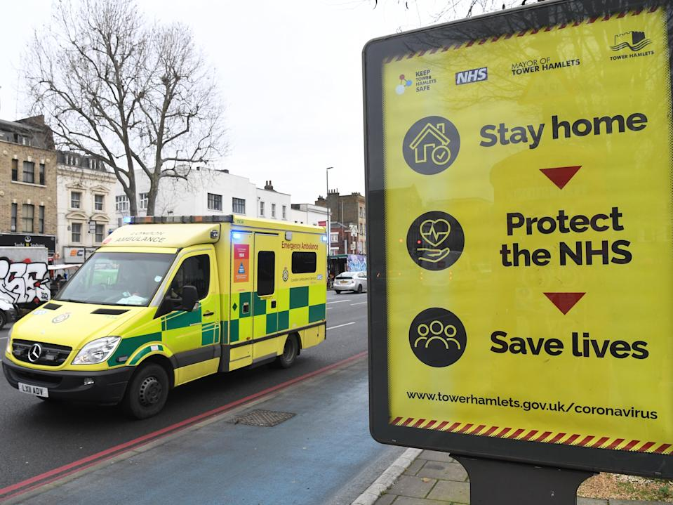 <p>An ambulance drives past near the Royal London hospital in London, as the NHS continues to be under pressure over a sharp increase in hospital admissions in the country</p> (EPA)