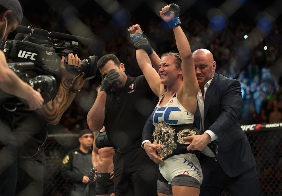 Miesha Tate celebrates her submission victory over Holly Holm after their women's bantamweight championship bout at UFC 196. (Brandon Magnus/Zuffa LLC/Zuffa LLC via Getty Images)