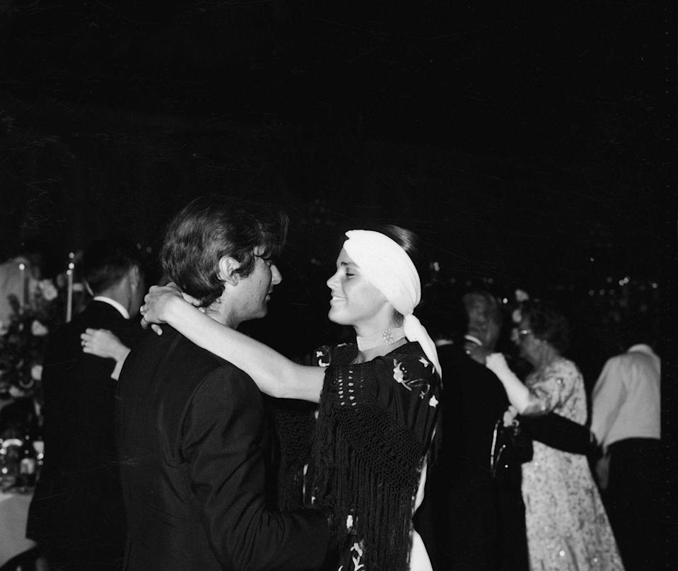 <p>At a much tamer Academy Awards after-party, actress Ali MacGraw and her film producer husband, Robert Evans, find a quiet moment to themselves. The party was a year before the actress's nomination for <em>Love Story</em>.</p>