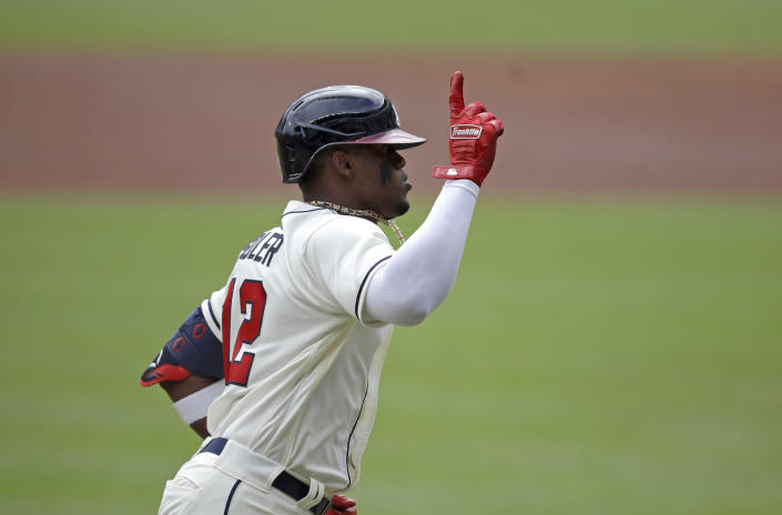 Atlanta Braves' Jorge Soler celebrates as he runs the bases after hitting a home run off New York Mets pitcher Noah Syndergaard in the first inning of a baseball game Sunday, Oct. 3, 2021, in Atlanta. (AP Photo/Ben Margot)