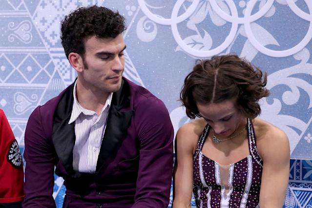 SOCHI, RUSSIA - FEBRUARY 12: Meagan Duhamel and Eric Radford of Canada wait for their score after competing in the Figure Skating Pairs Free Skating during day five of the 2014 Sochi Olympics at Iceberg Skating Palace on February 12, 2014 in Sochi, Russia. (Photo by Matthew Stockman/Getty Images)