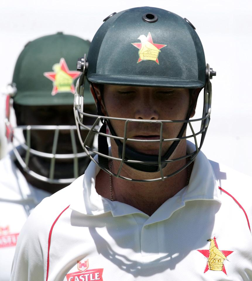 Zimbabwe's captain Brendan Taylor (front) and Hamilton Masakadza steady Zimbabwe's innings during the opening day of the first test match between Zimbabwe and Bangladesh on April 17, 2013 at the Harare Sports Club, Zimbabwe. AFP PHOTO/Jekesai Njikizana.