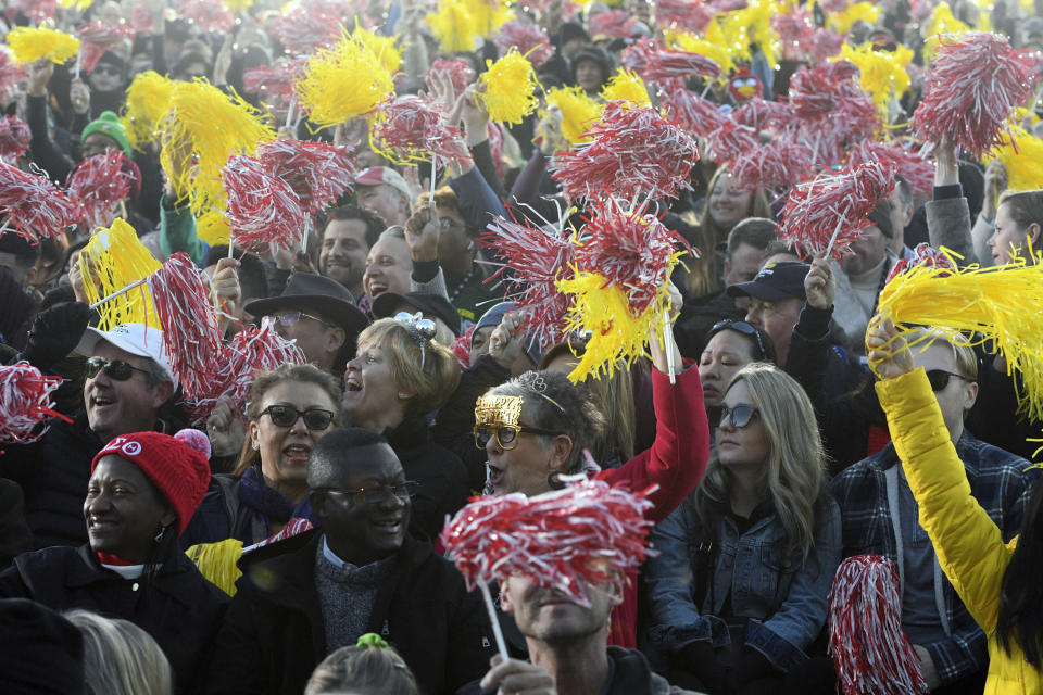 FILE - In this Wednesday, Jan. 1, 2020, file photo, Rose Parade spectators cheer for the television cameras at the 131st Rose Parade in Pasadena, Calif. Organizers have canceled the 2021 Rose Parade because of the impact of the coronavirus pandemic on long-range planning for the New Year's tradition. The Pasadena, California, Tournament of Roses Association said Wednesday that the decision was put off until organizers were certain that safety restrictions would prevent the staging of the 132nd parade. (AP Photo/Michael Owen Baker, File)