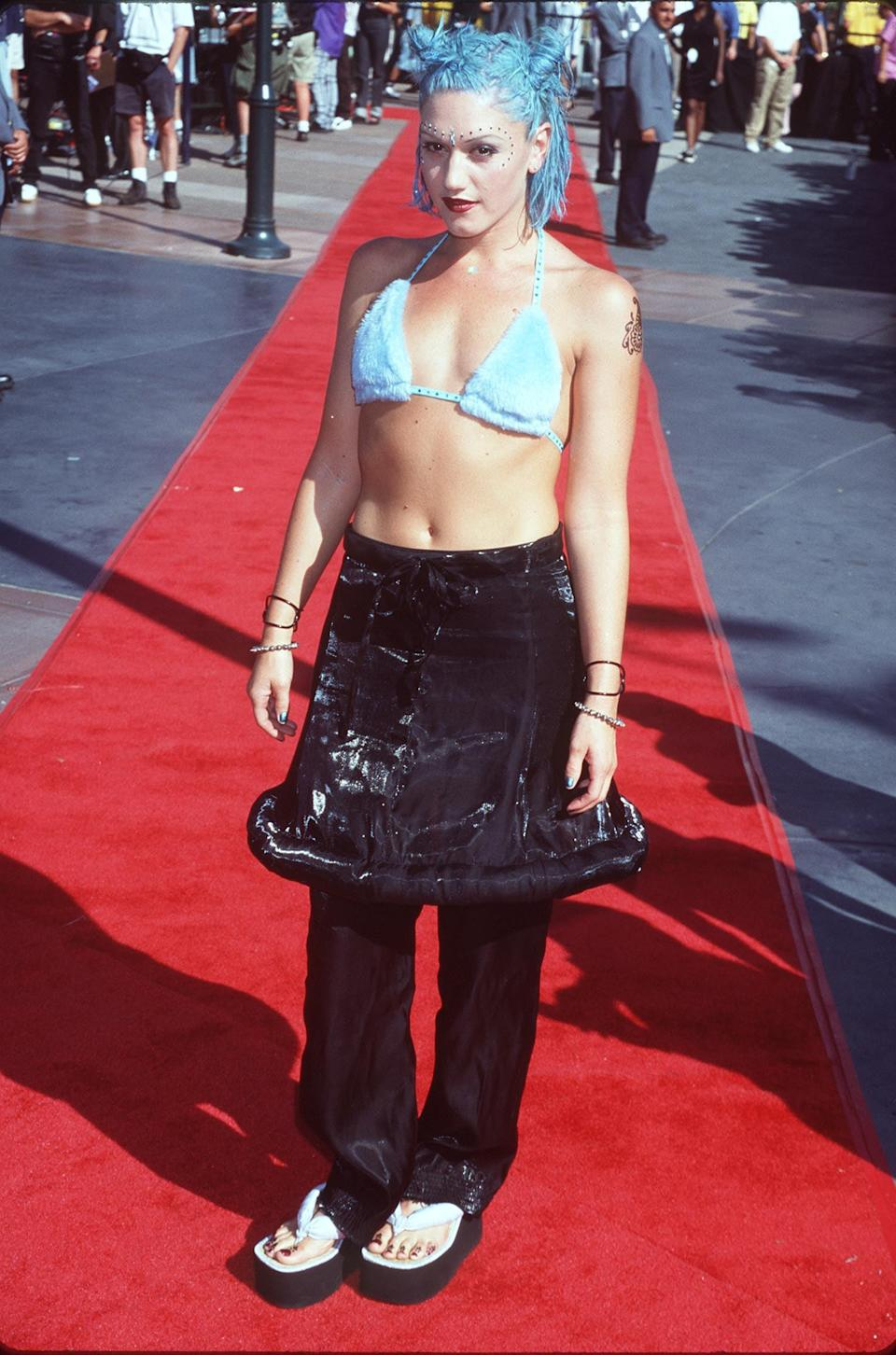 <p>At the 1998 MTV Video Music Awards wearing a blue bikini top and black skirt over pants.</p>