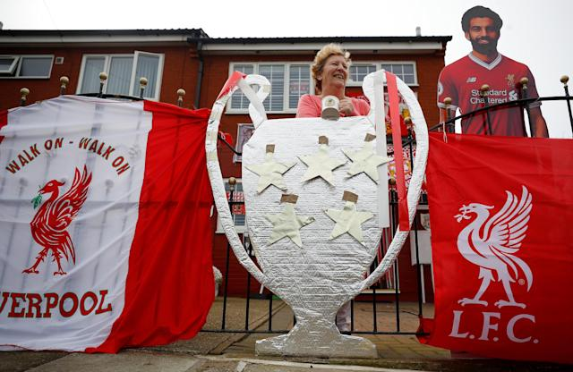 Liverpool Football Club supporter Emily Farley poses outside her house, which she has decorated ahead of the club's Champions League final appearance against Real Madrid, in Liverpool Britain May 9, 2018. REUTERS/Phil Noble