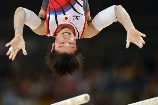 "Japan's gymnast Kohei Uchimura competes on the parrallel bars during the men's qualification of the artistic gymnastics event of the London Olympic Games. Uchimura said he was ""not worried"" about his own performance levels, but conceded that improvements needed to be made"