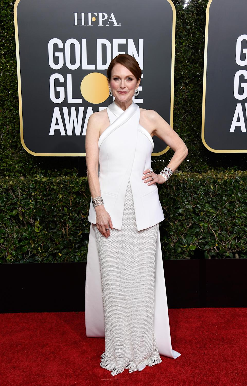 <p>Moore wore a fashion forward white ensemble by Givenchy.<br>Image via Getty Images. </p>