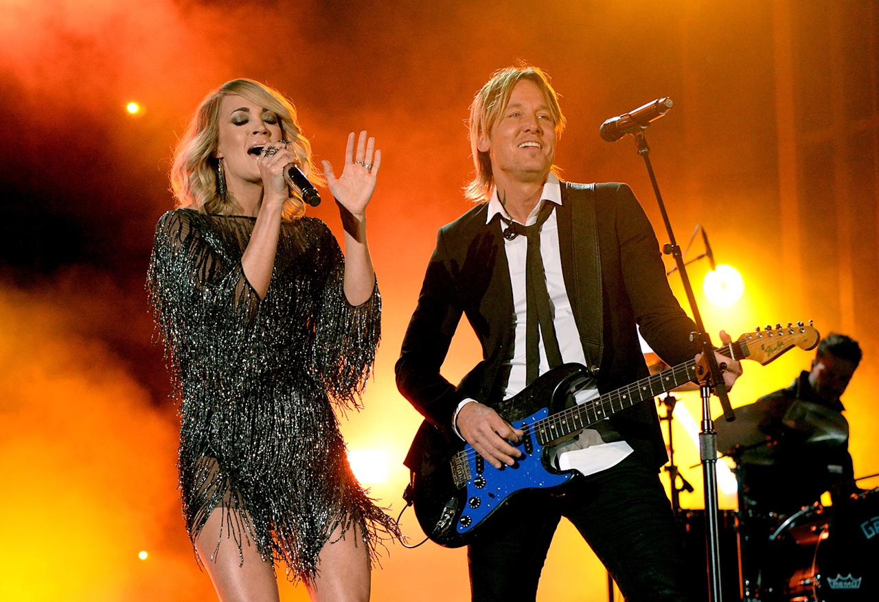 <p>Carrie Underwood and Keith Urban perform onstage during the 52nd Academy Of Country Music Awards at T-Mobile Arena on April 2, 2017 in Las Vegas, Nevada. (Photo by Kevin Mazur/ACMA2017/Getty Images for ACM) </p>