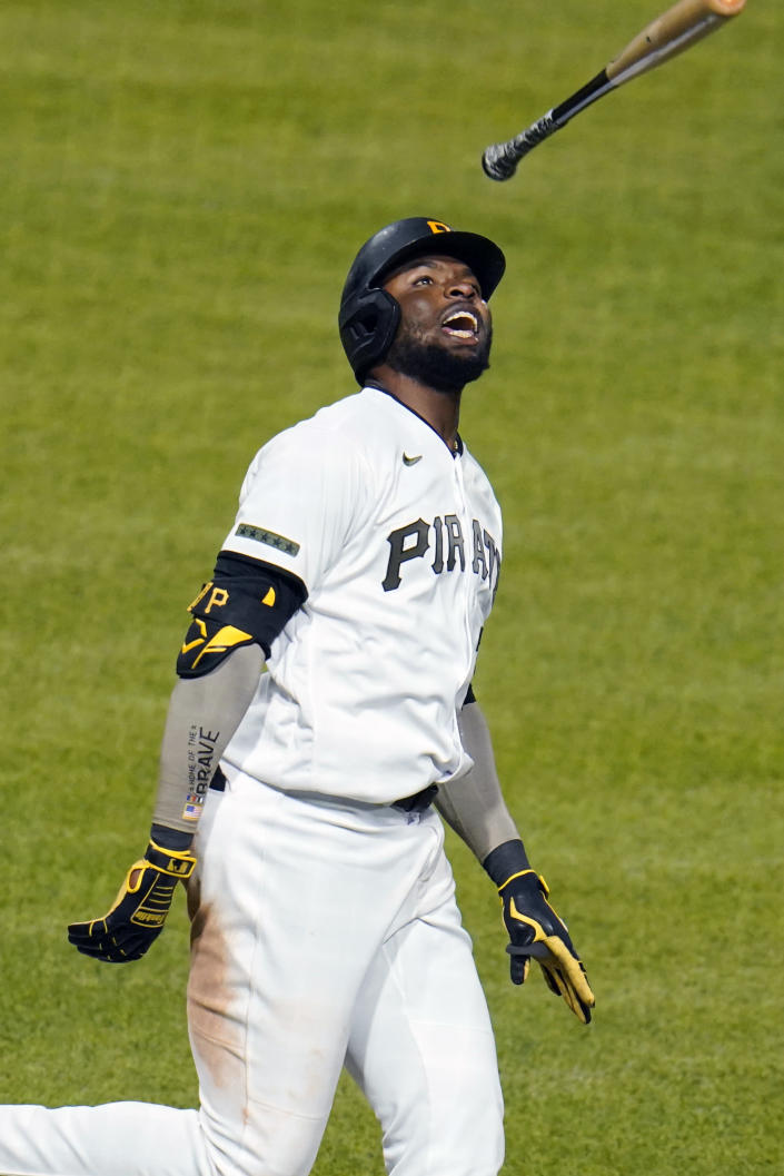 Pittsburgh Pirates' Gregory Polanco tosses his bat after driving in the winning run with a sacrifice fly off San Francisco Giants relief pitcher Caleb Baragar during the 11th inning of a baseball game in Pittsburgh, Friday, May 14, 2021. (AP Photo/Gene J. Puskar)