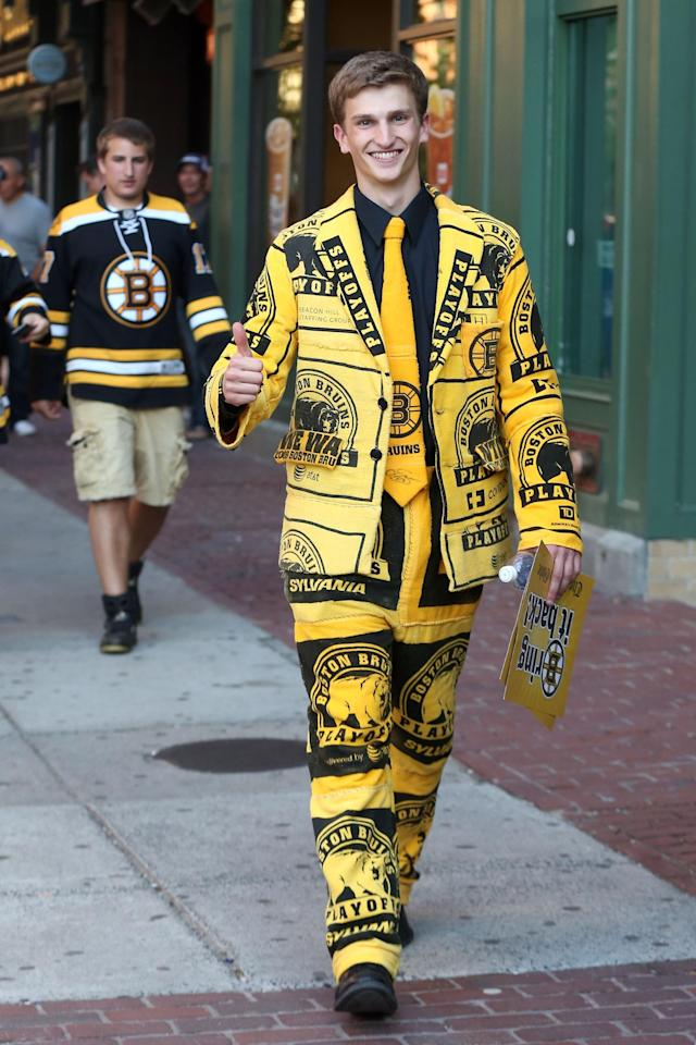 BOSTON, MA - JUNE 19: A fan of the Boston Bruins arrives at the arena to watch the Bruins host the Chicago Blackhawks in Game Four of the 2013 NHL Stanley Cup Final at TD Garden on June 19, 2013 in Boston, Massachusetts. (Photo by Bruce Bennett/Getty Images)