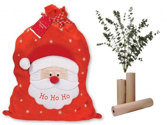Wow Party Supplies large Christmas gift sack, £4.98; Flowerbx green baby blue eucalyptus foliage, £35; Staples kraft brown paper, £1.93.
