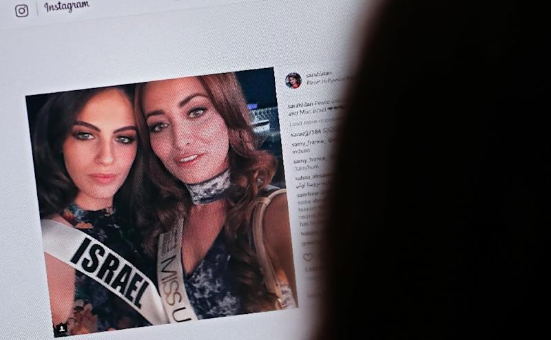 "A picture taken on November 21, 2017, shows a ""selfie"" posted on Instagram by Sarah Idan -- ""Miss Iraq USA 2016"" and ""Miss Iraq Universe 2017"" -- with Adar Gandelsman, ""Miss Universe Israel 2017"""