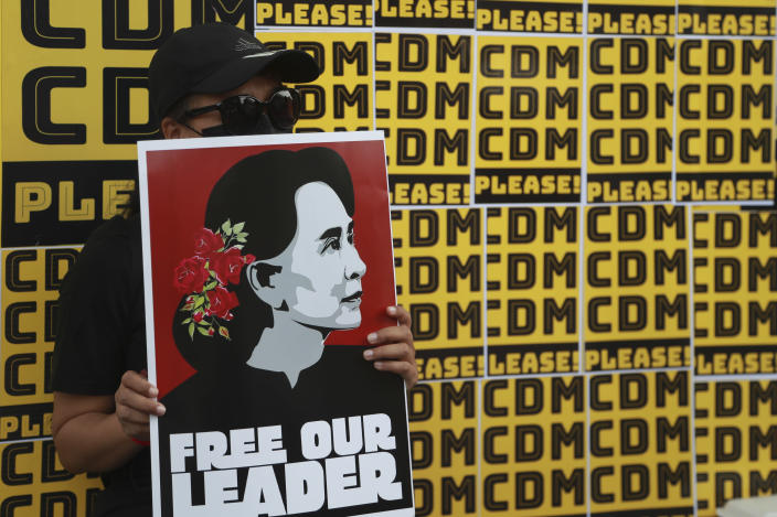 Protesters hold placards with images of ousted leader Aung San Suu Kyi during an anti-coup protest outside the Hledan Centre in Yangon, Myanmar, Sunday, Feb. 21, 2021. Police in Myanmar shot dead a few anti-coup protesters and injured several others on Saturday, as security forces increased pressure on popular revolt against the military takeover. (AP Photo)