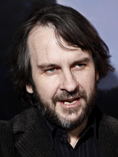 """FILE - In this Dec. 7, 2009 file photo, Peter Jackson arrives at the premiere of """"The Lovely Bones"""" in Los Angeles. New Zealand's capital is preparing for the world premiere of the opening film in """"The Hobbit"""" trilogy by showcasing an artisan festival selling all manner of small-folk paraphernalia, laying a red carpet that will extend 500 yards through central Wellington and even renaming the city itself after the trilogy's fictional setting of Middle-earth. Wellington is planning to spend 1.1 million New Zealand dollars ($900,000) to mark the Nov. 28 premiere of """"The Hobbit: An Unexpected Journey"""" at the Embassy Theatre. It's a fitting venue for the movie directed by Wellington resident Jackson and filmed throughout New Zealand. (AP Photo/Matt Sayles, File)"""