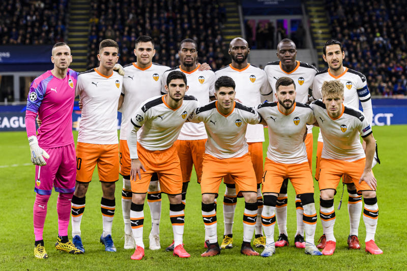 MILAN, ITALY - FEBRUARY 19: (l-R) Valencia CF squad poses for team photo with Goalkeeper Jaume Domenech, Ferran Torres, Maxi Gomez, Geoffrey Kondogbia, Eliaquim Mangala, Mouctar Diakhaby, Daniel Parejo, Gonçalo Guedes, Carlos Soler, Jose Gaya and Daniel Wass during the UEFA Champions League round of 16 first leg match between Atalanta and Valencia CF at San Siro Stadium on February 19, 2020 in Milan, Italy. (Photo by Marcio Machado/Eurasia Sport Images/Getty Images)