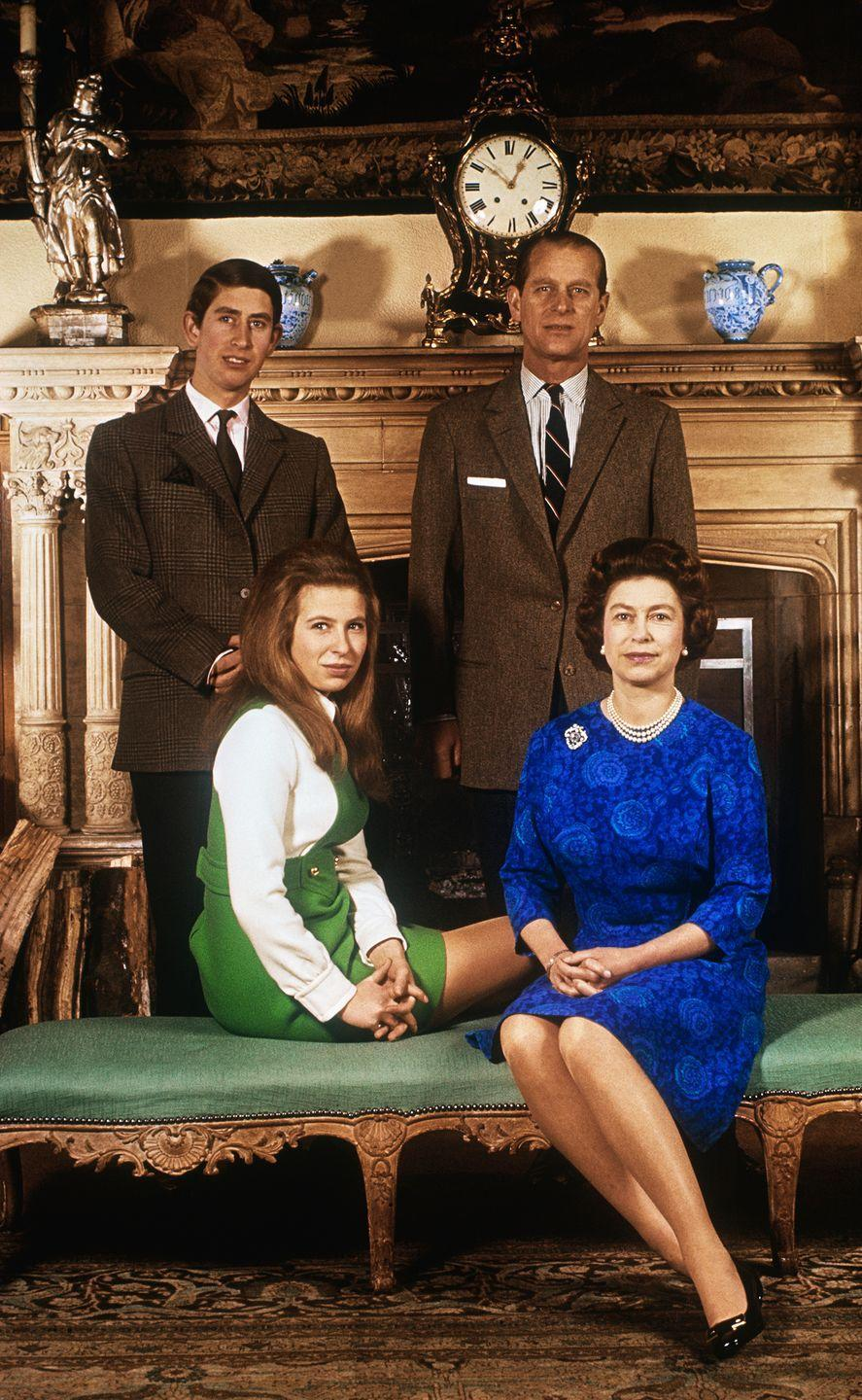 """<p>Prince Charles, Prince Philip, Princess Anne, and Queen Elizabeth II pose for a family portrait at <a href=""""https://www.sandringhamestate.co.uk/"""" rel=""""nofollow noopener"""" target=""""_blank"""" data-ylk=""""slk:Sandringham House"""" class=""""link rapid-noclick-resp"""">Sandringham House</a>, Her Majesty's country home near Norfolk, England. The photo was taken ahead of their royal tour to Australia and New Zealand.</p>"""