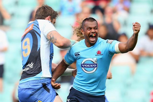 SYDNEY, AUSTRALIA - FEBRUARY 23: Kurtley Beale of the Waratahs celebrates scoring a try during the round two Super Rugby match between the Waratahs and the Western Force at Allianz Stadium on February 23, 2014 in Sydney, Australia. (Photo by Mark Kolbe/Getty Images)