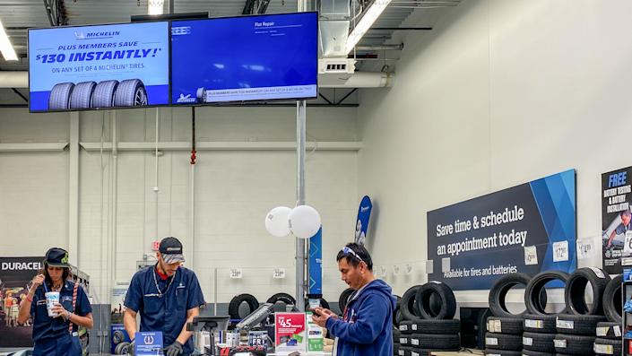 Orlando,FL/USA -11/16/19: The Tire and Battery aisle of a Sams Club Wholesale retail store with a variety of tires and batteries ready to be purchased by consumers.
