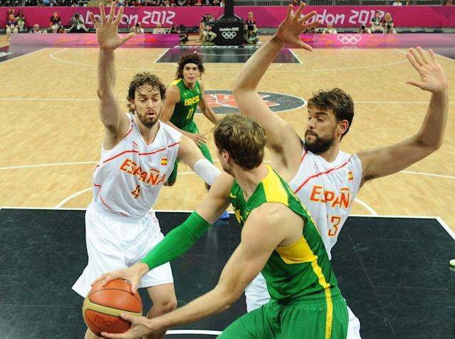 LONDON, ENGLAND - AUGUST 06: Tiago Splitter (C) of Brazil vies with Pau Gasol (L) and Marc Gasol of Spain during the Men's Basketball Preliminary Round match between Spain and Brazil on Day 10 of the London 2012 Olympic Games at Basketball Arena on August 6, 2012 in London, England. (Photo by Mark Ralston - IOPP Pool /Getty Images)