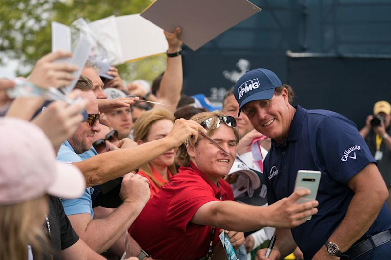 A spectator takes a selfie with Mickelson at the 2019 PGA Championship.