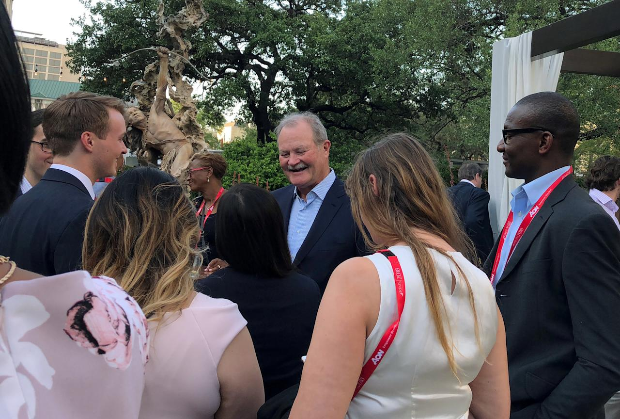 Brian Duperreault, CEO of American International Group Inc. (AIG), speaks with risk management students at a reception hosted by the Bermuda Business Development Agency during the Risk Management Society (RIMS) annual conference in San Antonio, Texas, U.S., April 17, 2018. Picture taken on April 17, 2018.  REUTERS/Suzanne Barlyn