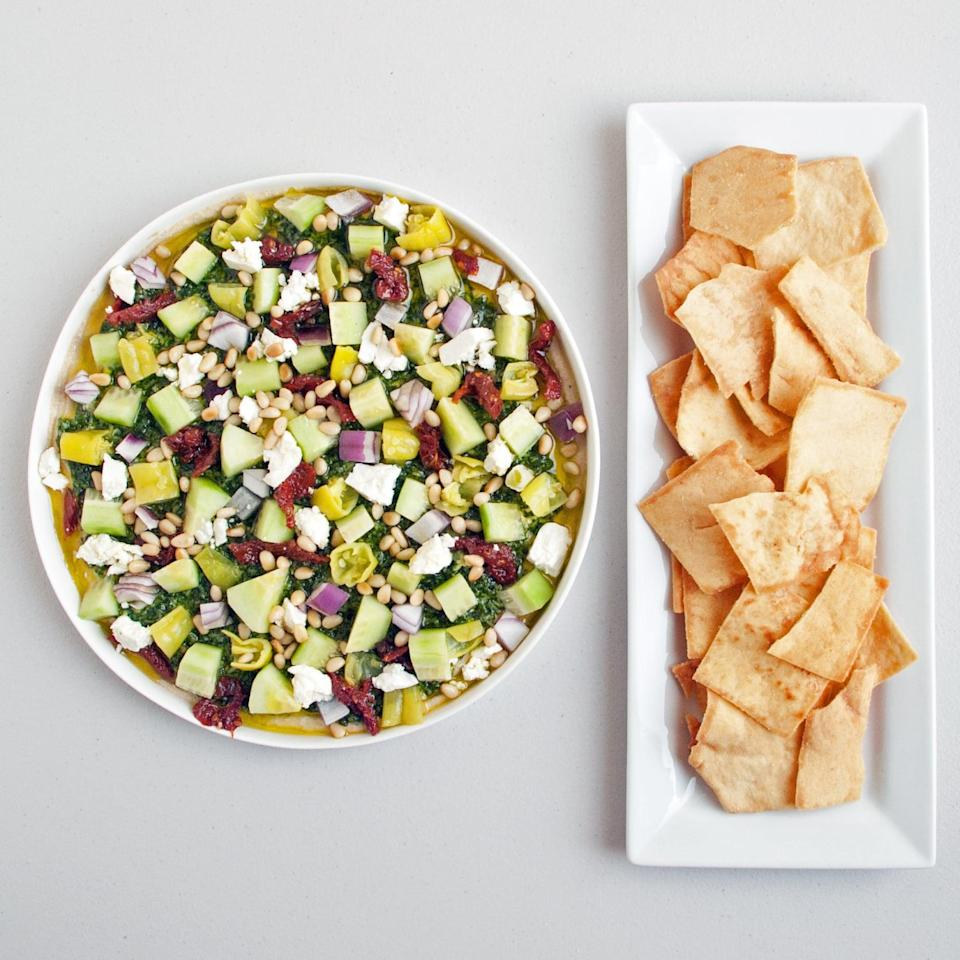 """<p>Like a Mediterranean take on the Southwestern star, seven-layer dip, this hummus-based feast for the eyes packs a variety of crave-worthy flavors into each and every bite. Trust us, you'll want this after a long day in the sunshine.</p> <p><strong>Get the recipe</strong>: <a href=""""https://www.popsugar.com/food/Mediterranean-Layered-Dip-27062184"""" class=""""link rapid-noclick-resp"""" rel=""""nofollow noopener"""" target=""""_blank"""" data-ylk=""""slk:Mediterranean layered dip"""">Mediterranean layered dip</a></p>"""