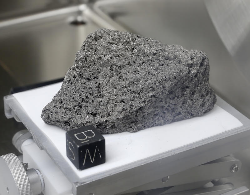 "Collected during Apollo 17, a 3.5 billion year old basalt rock known as ""The Children of the World"" or ""The Goodwill Sample"" is displayed in the lunar lab at the NASA Johnson Space Center Monday, June 17, 2019, in Houston. It was used for to make samples that were gifted to every country on earth. (Photo: Michael Wyke/AP)"