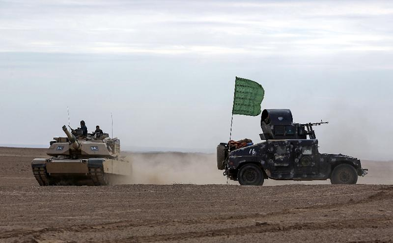 The Pentagon acknowledges that Hashd al-Shaabi, a pro-Iranian Iraqi paramiltary group pictured here in the desert bordering Syria,  used US M1 Abrams tanks that had been sold exclusively to the Iraqi army