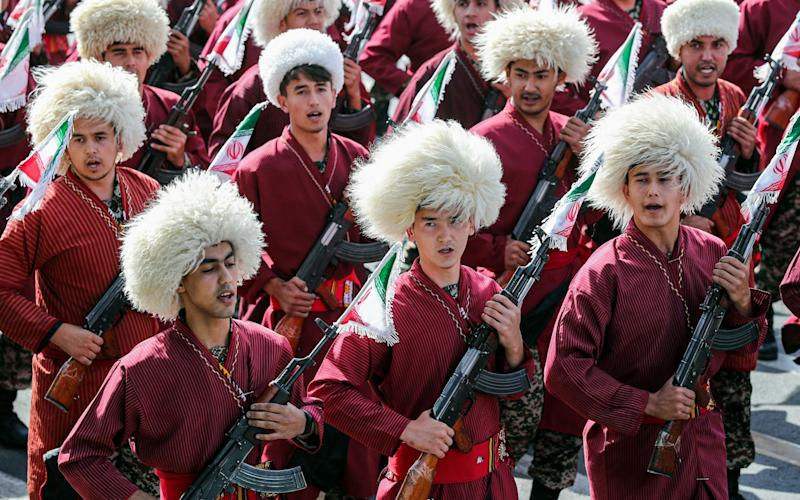 Iranian Turkmen Basij militia members marching during the annual