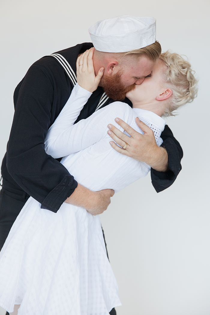 """<p>The image of a sailor kissing a nurse in Times Square to celebrate America's victory over Japan in WWII is one of the most iconic photographs of all time. The DIY couple's costume is a snap to make happen - and just think of all the lip-locking you and your honey will get to do if you wear it.</p><p><strong>Get the tutorial at <a href=""""https://sayyes.com/2015/10/halloween-couples-costume-kissing-sailor"""" rel=""""nofollow noopener"""" target=""""_blank"""" data-ylk=""""slk:Say Yes"""" class=""""link rapid-noclick-resp"""">Say Yes</a>.</strong></p><p><a class=""""link rapid-noclick-resp"""" href=""""https://www.amazon.com/Adult-Cotton-Sailor-Costume-Hat/dp/B00NHVDCYK/ref=asc_df_B00NHVDCYK/?tag=syn-yahoo-20&ascsubtag=%5Bartid%7C10050.g.4616%5Bsrc%7Cyahoo-us"""" rel=""""nofollow noopener"""" target=""""_blank"""" data-ylk=""""slk:SHOP SAILOR HATS"""">SHOP SAILOR HATS</a><br></p>"""