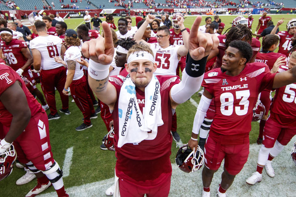 Temple quarterback Anthony Russo (15) celebrates with teammates after their 30-28 win over Memphis in an NCAA college football, Saturday, Oct. 12, 2019, in Philadelphia. T (AP Photo/Chris Szagola)