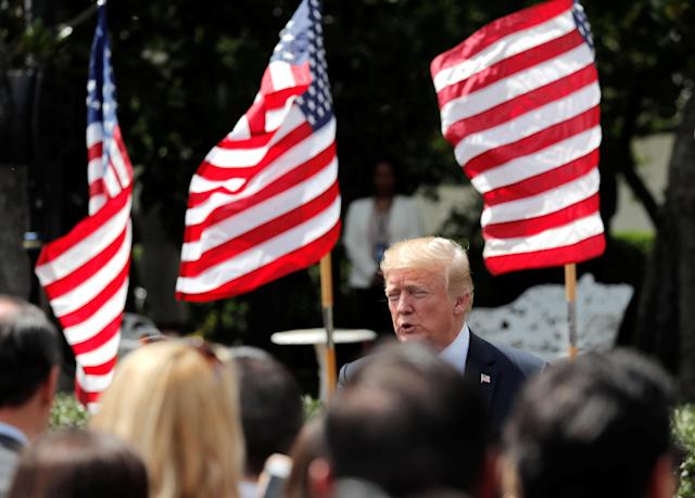 "U.S. President Donald Trump participates in a ""celebration of America"" event on the South Lawn of the White House in Washington, U.S., June 5, 2018. The event was arranged after Trump canceled the planned visit of the Super Bowl champion Philadelphia Eagles to the White House. REUTERS/Carlos Barria"