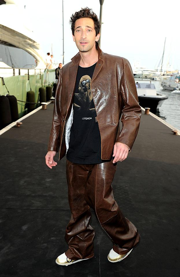 """We much prefer to see Oscar-winning hottie Adrien Brody (""""The Pianist"""") in our 2 Hot 2 Handle gallery, but he definitely earned a well-deserved spot in this week's What Were They Thinking?! thanks to this ill-fitting leather suit and Lady Gaga tee. Venturelli/<a href=""""http://www.wireimage.com"""" target=""""new"""">WireImage.com</a> - May 19, 2010"""