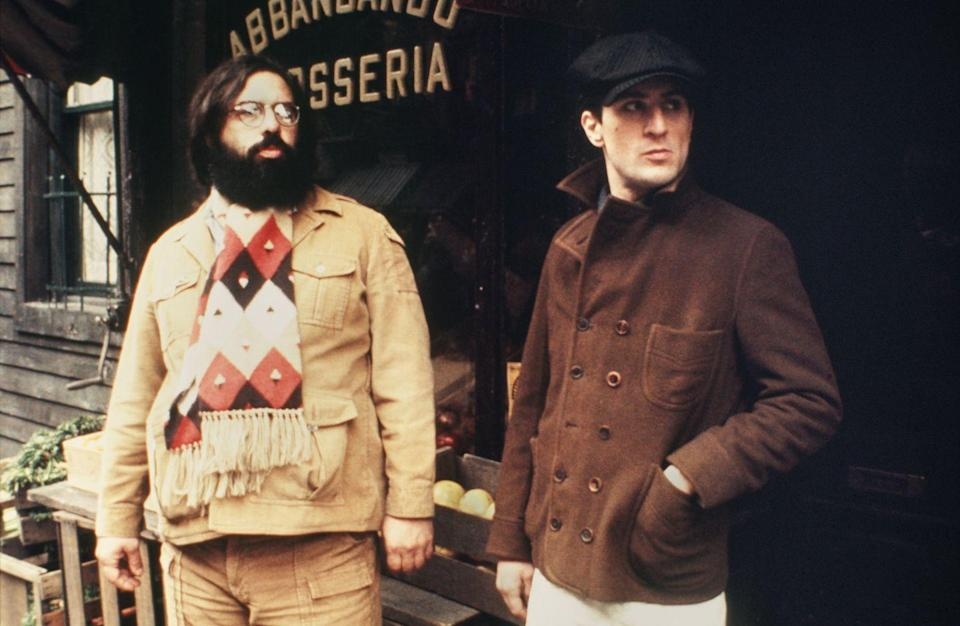 <p>Coppola stands off camera with De Niro while filming in New York City.</p>
