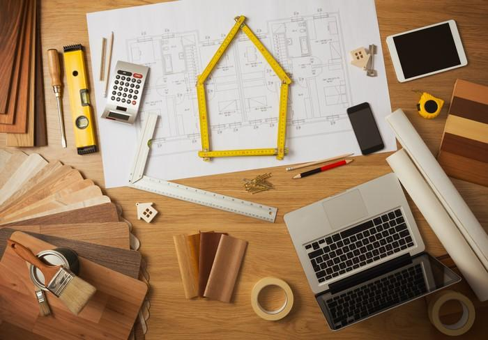 A number of home improvement tools spread out across a table.