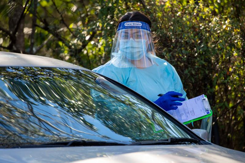 Nurses are seen doing COVID testing at a drive-thru fever clinic in Ipswich. Source: Getty