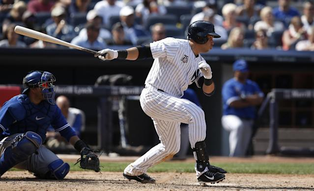 New York Yankees designated hitter Carlos Beltran hits an eighth-inning RBI single in a baseball game against the Toronto Blue Jays at Yankee Stadium in New York, Sunday, July 27, 2014. (AP Photo/Kathy Willens)