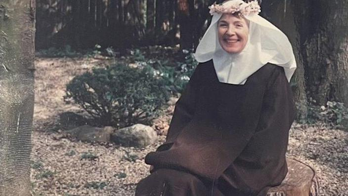 Sister Mary Joseph in her nun's habit with a flower crown