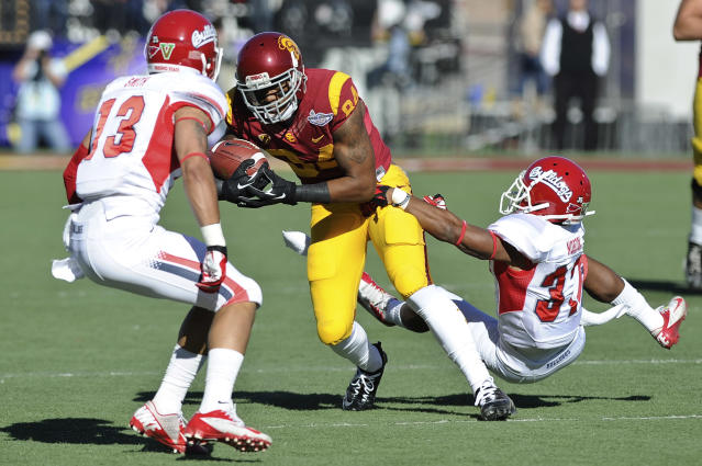 Southern California wide receiver Darreus Rogers (84) breaks free from Fresno State defensive back Jonathan Norton (37) during the first quarter of the Royal Purple Bowl NCAA college football game, Saturday, Dec. 21, 2013, in Las Vegas. (AP Photo/David Cleveland)
