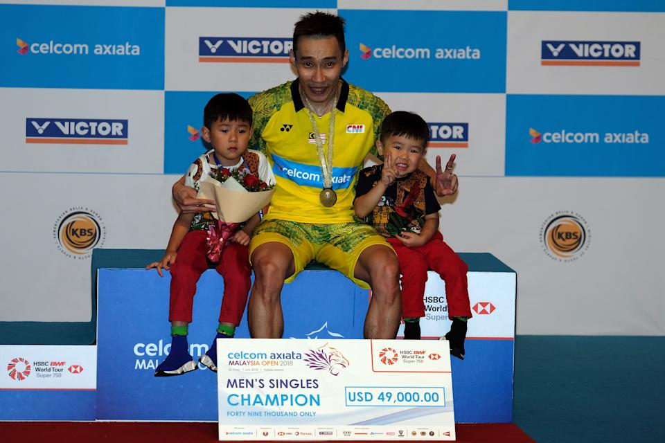 Lee Chong Wei poses with his sons Kingston Lee and Terrence Lee after winning  in the single final against He Kento Momota of Japan during Celcom Axiata Badminton Malaysia Open 2018 at Bukit Jalil Stadium, Kuala Lumpur on July 1, 2018.  (PHOTO: Getty Images)