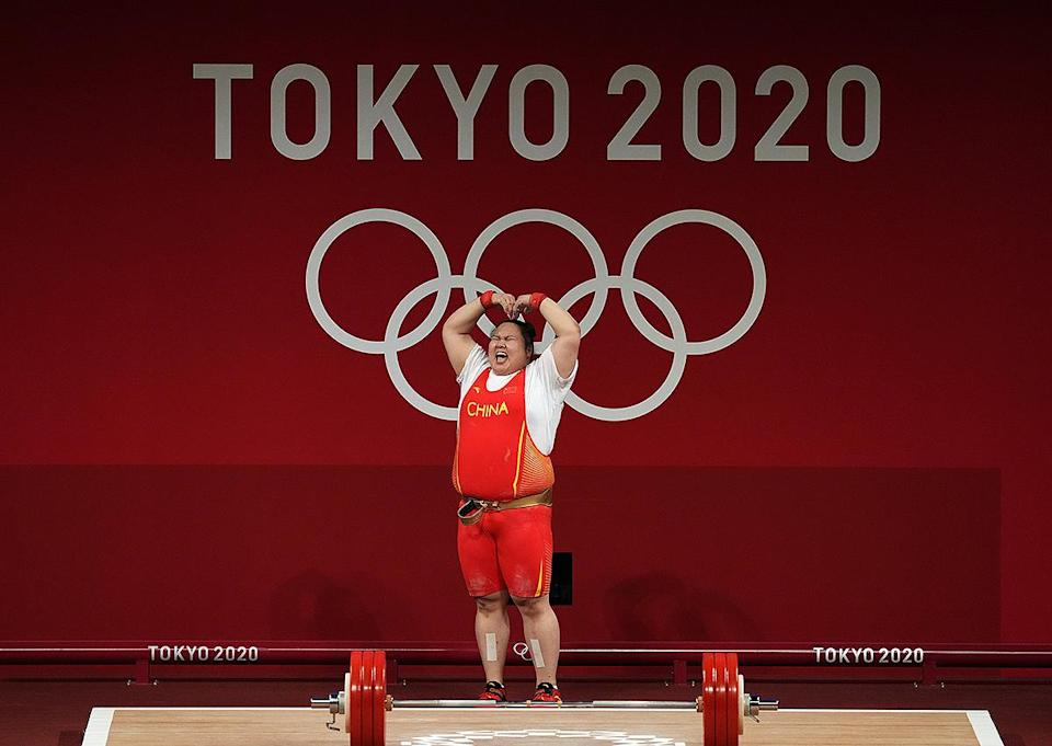 <p>China's Wenwen Li celebrates gold with a heart following the Women's +87kg Group A Weightlifting at Tokyo international Forum on August 2.</p>