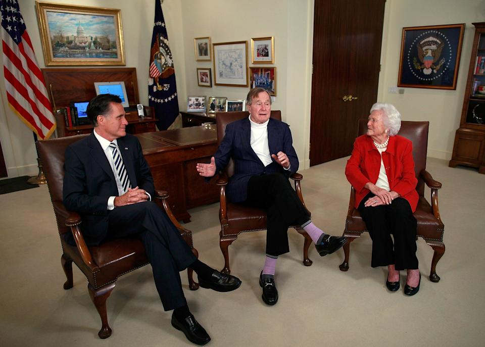 Republican presidential candidate Mitt Romney (left) meets with George H.W. and Barbara Bush at the former president's office on March 29, 2012, in Houston.