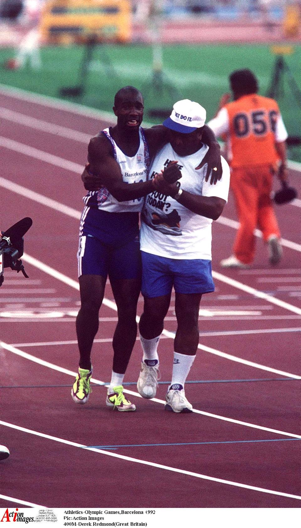 Athletics - 1992 Olympic Games, Barcelona, Spain  Pic:Action Images  400M - Derek Redmond (Great Britain) is helped to the finish by his dad