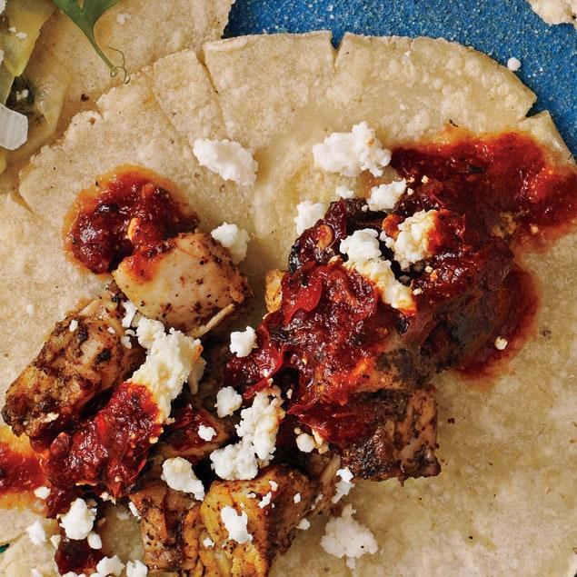 """Seared chicken thighs are coated in a quick pan sauce of ancho chili powder, toasty cumin, and leftover pan juices from cooking the chicken. Serve on tortillas or with yellow rice. <a href=""""https://www.epicurious.com/recipes/food/views/cumin-and-ancho-chicken-395915?mbid=synd_yahoo_rss"""" rel=""""nofollow noopener"""" target=""""_blank"""" data-ylk=""""slk:See recipe."""" class=""""link rapid-noclick-resp"""">See recipe.</a>"""