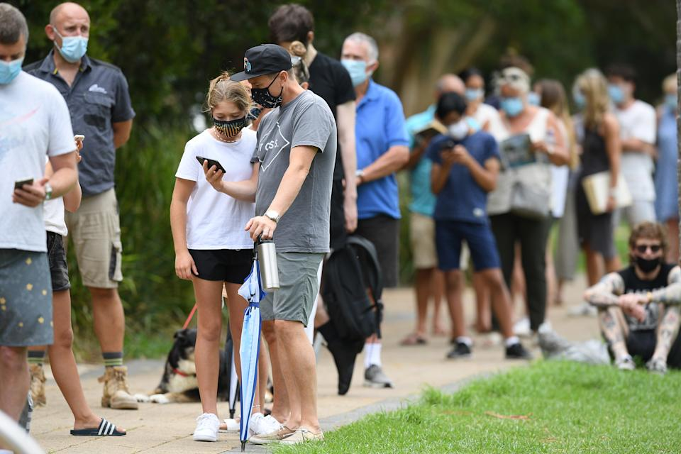 People line up to be tested at a pop-up COVID-19 testing facility at Avalon on Friday. Source: AAP