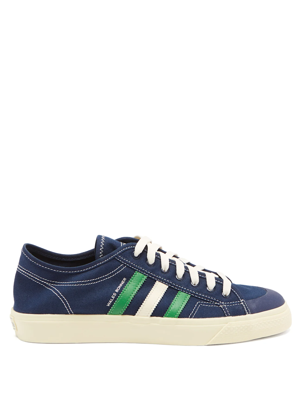 """A classic pair of sneakers is a staple in every dad's wardrobe. Make your dad's stand out in the crowd with this retro pair courtesy of British menswear label <a href=""""https://walesbonner.net/"""" rel=""""nofollow noopener"""" target=""""_blank"""" data-ylk=""""slk:Wales Bonner"""" class=""""link rapid-noclick-resp"""">Wales Bonner</a> and his collab with Adidas.<br><br><strong>Adidas x Wales Bonner</strong> Nizza Three-Stripes Canvas Trainers, $, available at <a href=""""https://go.skimresources.com/?id=30283X879131&url=https%3A%2F%2Fwww.matchesfashion.com%2Fus%2Fproducts%2FAdidas-X-Wales-Bonner-Nizza-three-stripes-canvas-trainers-1398305"""" rel=""""nofollow noopener"""" target=""""_blank"""" data-ylk=""""slk:MatchesFashion"""" class=""""link rapid-noclick-resp"""">MatchesFashion</a>"""